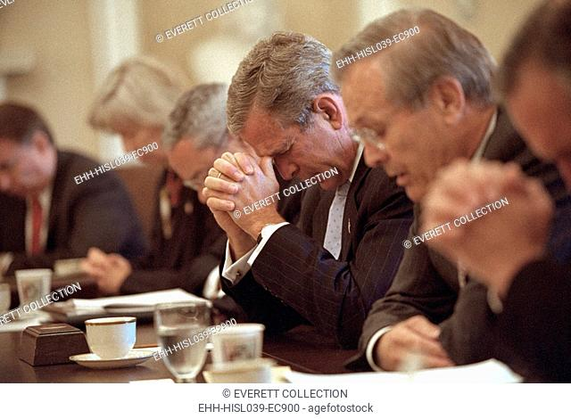 President George W. Bush opens a cabinet meeting with a prayer on Sept. 14, 2001. 3 days after the 9-11 Terrorist Attacks, Bush 43 is flanked by Sec