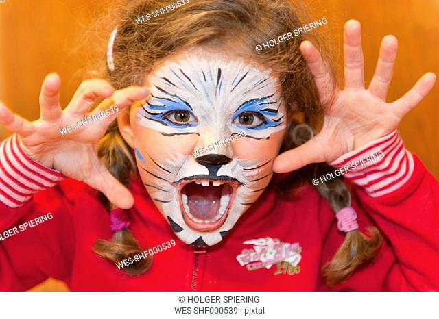 Germany, Ueberlingen, Girl with face paint, close up