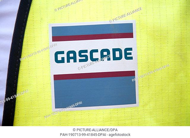 """26 June 2019, Mecklenburg-Western Pomerania, Stolpe: The writing """"""""GASCADE"""""""" can be seen on a safety vest. The Eugal consists of two strands as far as Weissack..."""