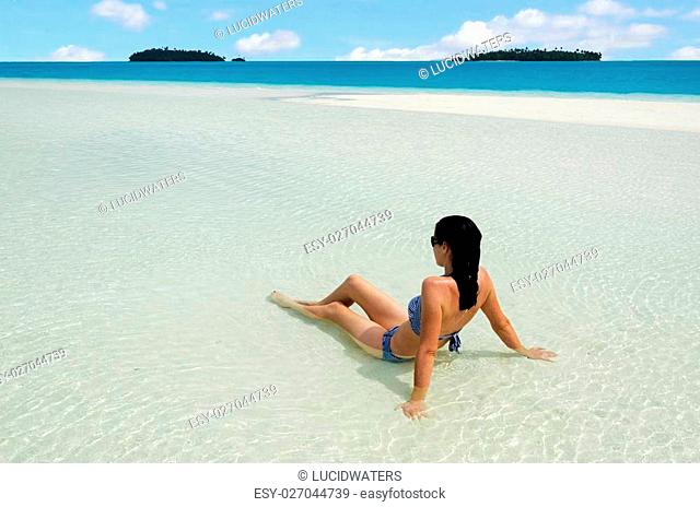 Sexy, young, beautiful woman relax on Aitutaki Lagoon, Cook Islands