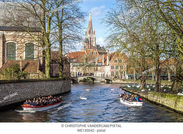 Tourists are boat tripping in Bruges