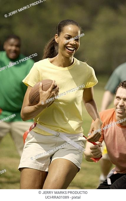 African woman playing football
