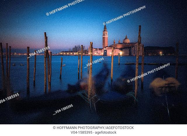 Mysterious view of San Giorgio Maggiore with gondolas in the foreground, Venice, Italy, Europe