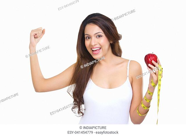 Portrait of woman holding an apple