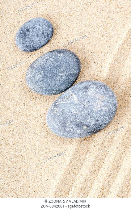 The stones on sand as a background