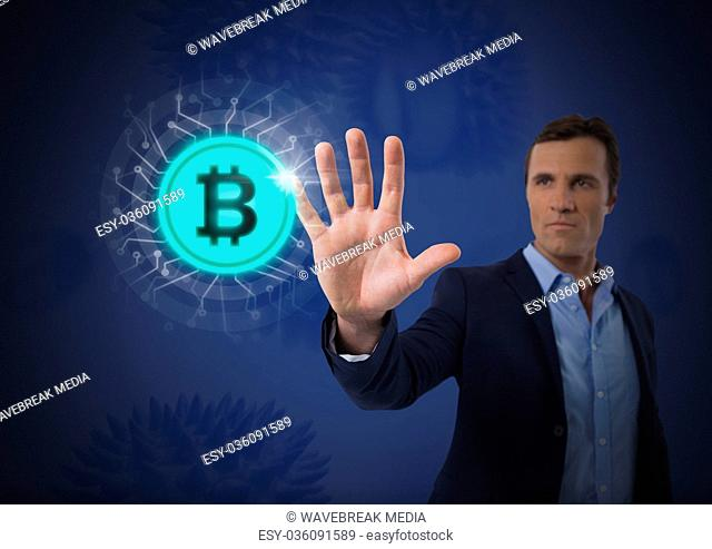 Businessman touching bitcoin graphic icon
