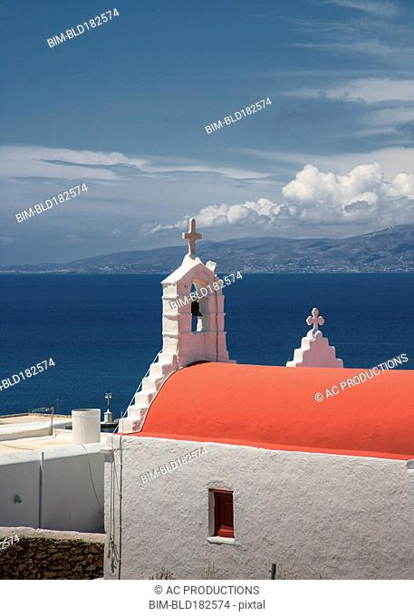 Traditional bell arch and seascape under blue sky