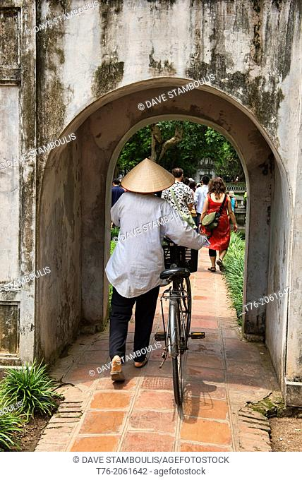 vendor and her bicycle at the Temple of Literature in Hanoi, Vietnam