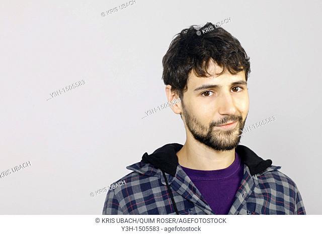 Studio shot of young man, looking at camera