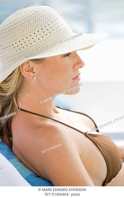 Woman relaxing poolside