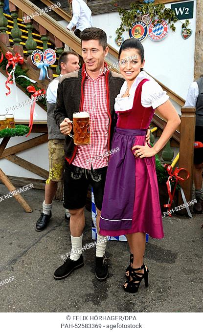 FC Bayern Munich player Robert Lewandowski and his wife Anna are pictured in a festival tent at Oktoberfest in Munich, Germany, 05 October 2014