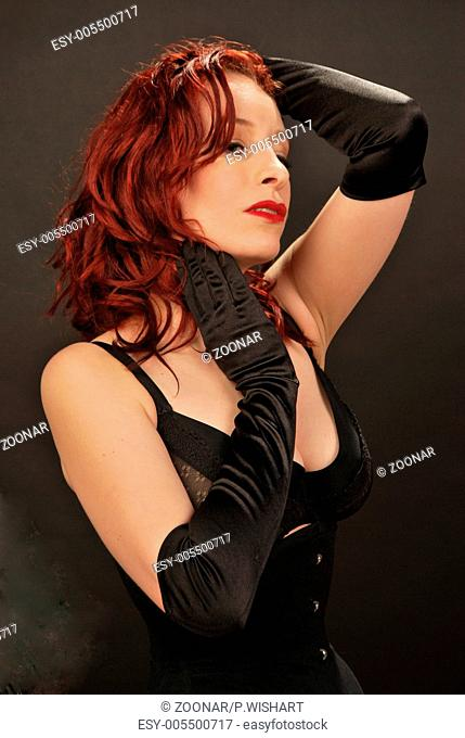 redhead with gloves