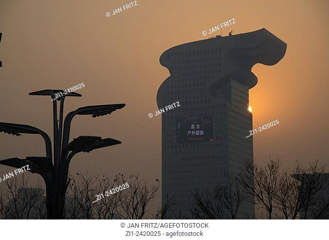 sunset and silhouette of ibm building at beijing china