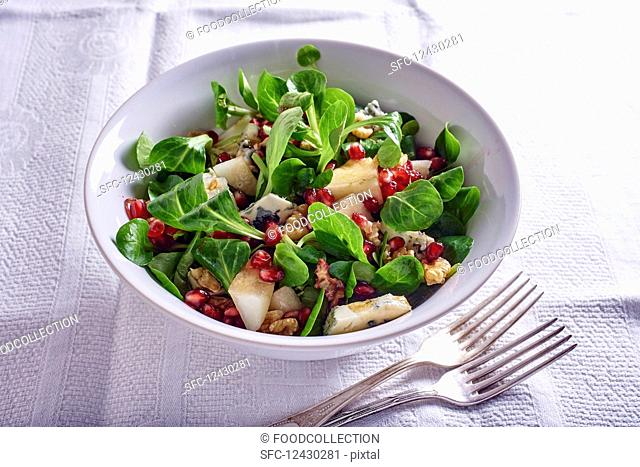 Lamb's lettuce salad with pears, gorgonzola, pomegranate seeds and nuts