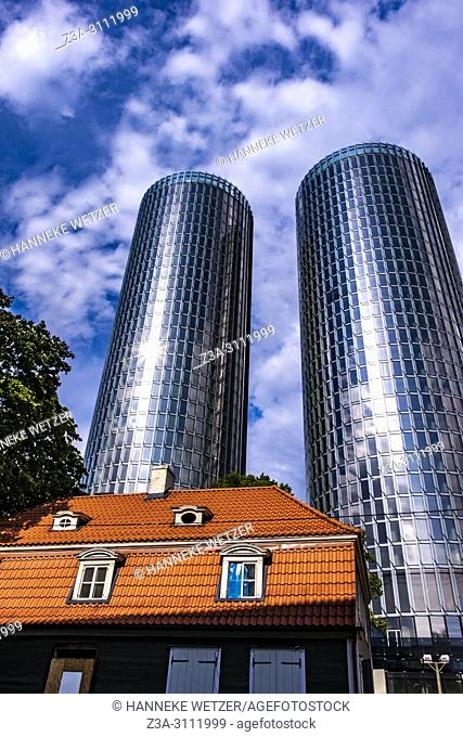 Traditional house in front of the newly built Z-Towers in Riga, Latvia, Europe