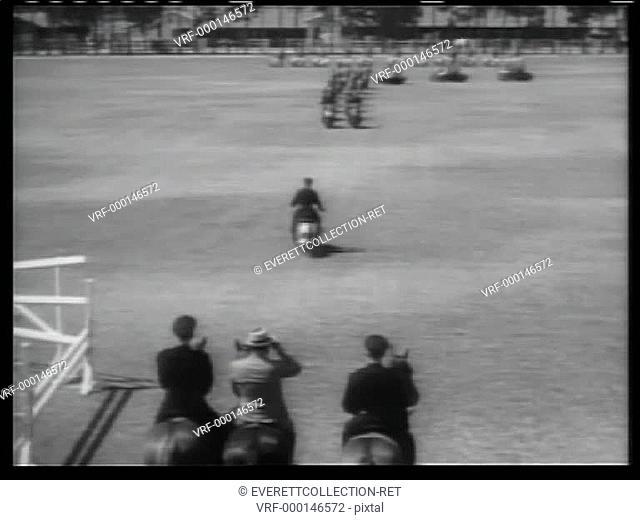 Policemen on motorcycles performing in open field