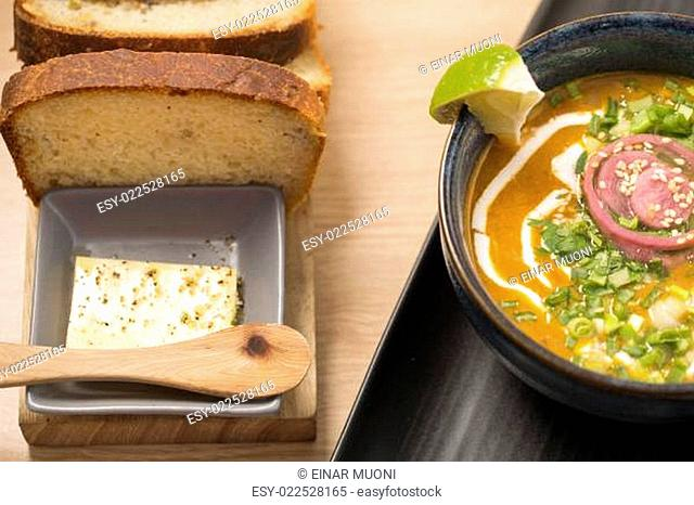 Ceramic bowl with delicious soup