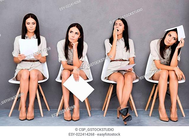 Waiting for interview. Digital composite of young businesswoman expressing different emotions while holding paper and sitting at the chair against grey...