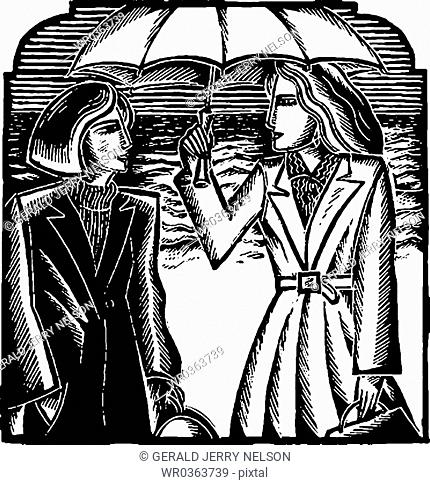 two businesswomen standing under umbrella