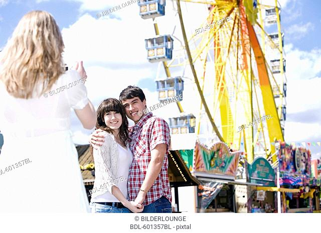 girl taking picture of teenage couple