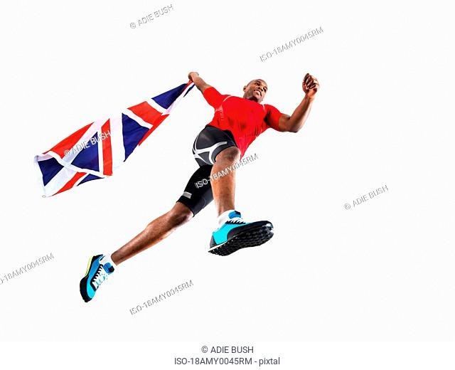 Male athlete running with union jack