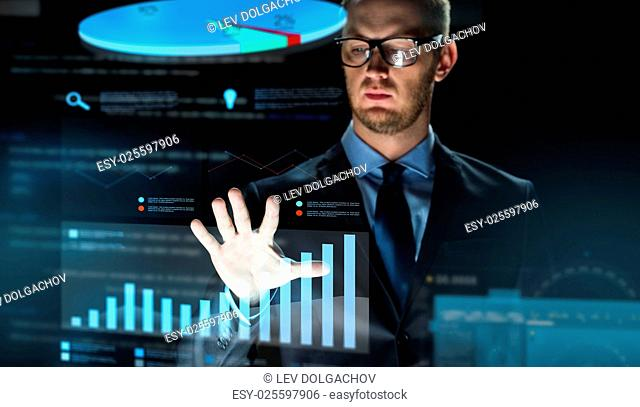 business, people, future technology, statistics and economics concept - close up of businessman touching chart projection on virtual screen over dark background