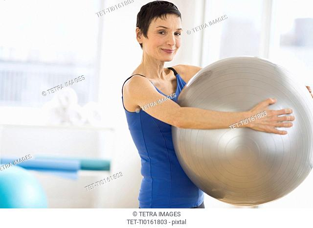 Portrait of mature woman exercising in gym