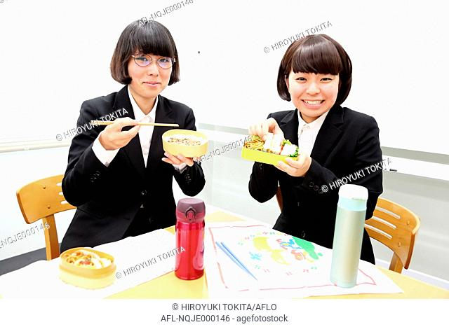 Young Japanese business people having lunch together