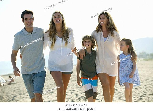 Family walking together at the beach
