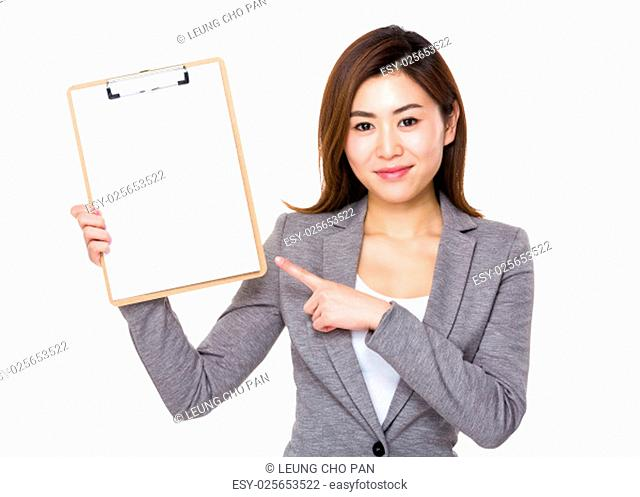 Asian businesswoman with finger point to clipboard