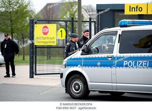 Police officer stand at the training grounds of Borussia Dortmund in Dortmund, Germany, 12 April 2017. Three explosions occurred next to the team bus of the...