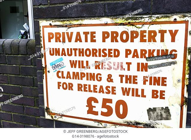 United Kingdom Great Britain England, London, Westminster, sign, parking warning, private property, unauthorized parking fines, clamping, sterling pounds symbol
