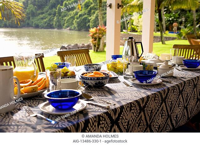 Private home in Parati Brazil. Back terrace, overlooking the sea, with the table set for breakfast