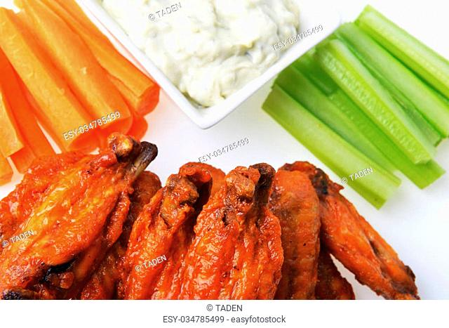 chicken wings with celery, carrot and blue cheese sauce