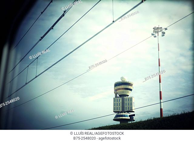 View of the control tower of the airport of Milan from the window of a train. Italy, Europe