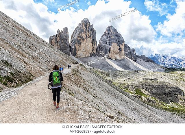 Woman hiker venturing to discover the Three Peaks of Lavaredo. Sesto Dolomites Trentino Alto Adige Italy Europe