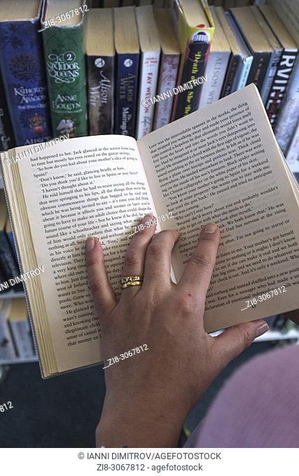Choosing a book in Library,UK