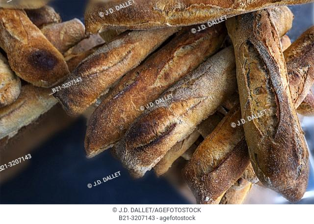 """France, Auvergne, Cantal, the french """"""""baguette"""""""" on the weekly street market at Maurs"""