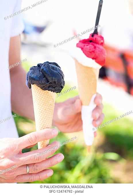 Black vanilla ice cream in a cone