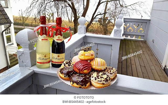 colourful jam doughnuts on a terrace at silvester 2016, Germany