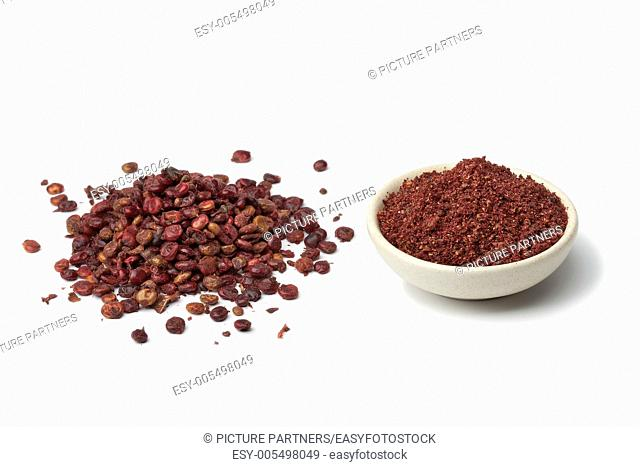 Ground Sumac and berries on white background