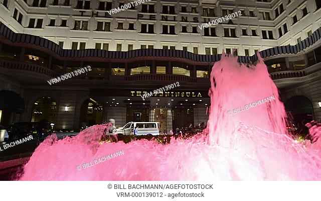 Hong Kong China Peninsula Hotel pink fountains in front of expensive exclusive hotel in Kowloon