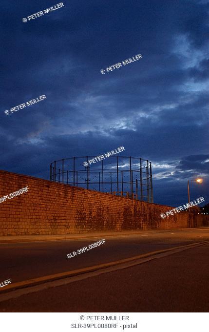 Metal structure behind brick wall