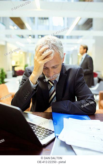Businessman resting while working in office building