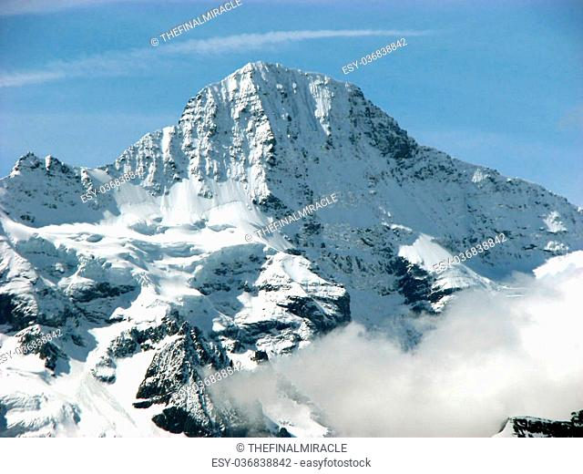 A picturesque view of a snowy mountain peak in the Swiss Alps