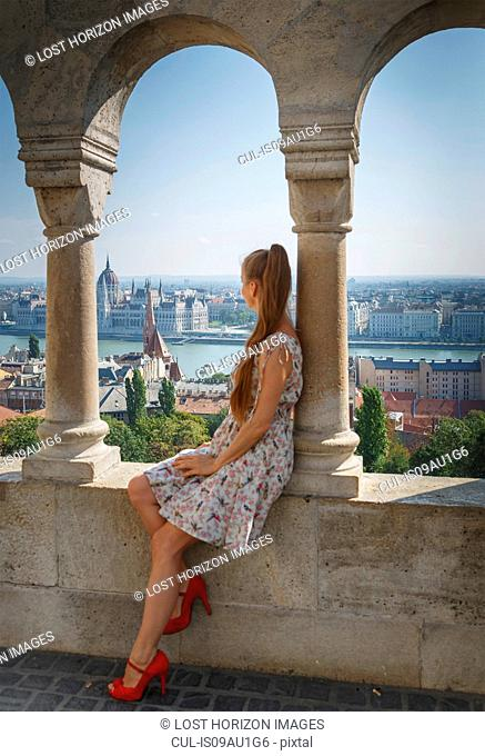 Mid adult woman looking at view of Buda from the Fisherman's Bastion, Budapest, Hungary
