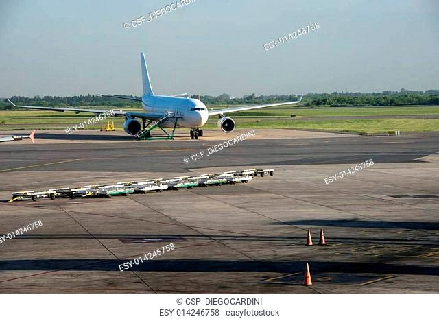 Aeroplane at airport and Orange Cones over track. Ezeiza, Buenos