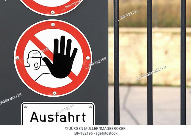 Warning sign and sign Ausfahrt exit on a gate