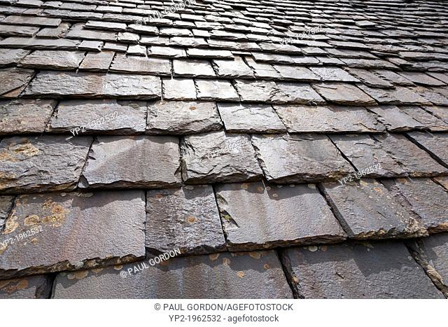 Typical slate roof tiles on a cabin in the Hamlet of Biados, Valle de Chistau - Huesca, Aragon, Spain