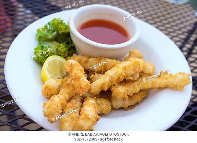 Fried calamari with hot sauce dish